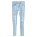 Ripped Zip Front Pencil Jeans in Light Wash