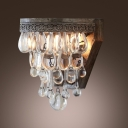 Single Light Wall Sconce Features Beautiful Crystal Teardrops and Delicate Back Plate