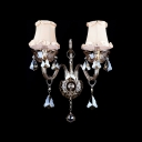 Grand  Ivory Fabric Shades and Clear Crystal Formed Sparkling Two Light Wall Sconce