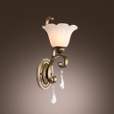 Faceted Crystal Drop Hangs From the Bottom of  Beautiful Wall Sconce