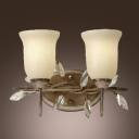 Timeless Classic Two Light Wall Sconce Topped with Beautiful Glass Shades Adorned by Dazzling Clear Crystal Beads