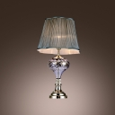 Classic Lines Executed in Sparkling Crystal and Graceful Fabric Shade Complete Eye-catching Table Lamp