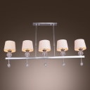 Grand Chandelier Style Island Light Adorned with Off-white Fabric Shades and Crystal Drops