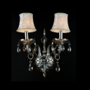 Elegant Two-light Wall Sconce with Beautiful Crystal Drops Featuring Glass-crafted Framework and White Fabric Bell Shades