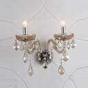Decorative Scrolling Arms Add Elegance to Glistening Two Light Crystal Wall Sconce