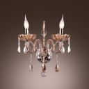 Two Candle-style Light Fixture Illuminate this Elegant Champagne Crystal Wall Sconce