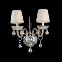 Luxurious Two Lights Wall Sconce Adorned with Graceful Scrolling Arms and Crystal Drops
