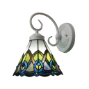 Tiffany Wall Sconce Crafted with Peacock Tail Pattern Glass Shade and Wrought Iron Base