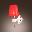 Graceful Scrolls and Beige Fabric Hardback Shade Makes Lustrous Wall Light Sconce
