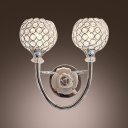 Striking Contemporary Style Wall Sconce Features Globe Design and Graceful Scrolls