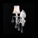 Glittering Silver Finish Base and Crystal Drops Add Charm to Shimmering Wall Sconce