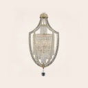 Decidedly Modern Laser-cut Iron Frame Chandelier Offers Versatile Home Decor Option
