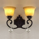 Sophisticated Two Light Wall Sconce Adorned with Beautiful Clear Crystal Drops and Black Finish  Iron Scrolling Arms
