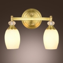 Fabulous Two Light Wall Sconce Features Beautiful Crystal Globes and Delicate Gold Finish