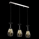 Chrome Finish Mounting Hardware Embellishes Multi Light Pendant with Three Clear Glass Globes and Strings of Glistening Clear Crystal Beads