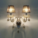 Shimmering Crystal Embellishments and Graceful Curving Crystal Arms Made Delightful Two-light Wall Sconce Elegant Look