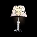 Elegant Table Lamp Features Flowers on White Fabric Shade with Black Edging