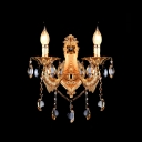 Lovely and Luxurious Gold Two Light Wall Sconce with Elegant Crystals and Chic Fish-like Scrolling Arms