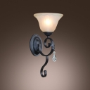 Gleaming Single Light Wall Sconce Adorned with Graceful Scrolling Arm and Clear Crystal Drop