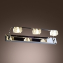 Three Slender Arms and Sculptural Crystal Shades Complete Delightful Wall Sconce