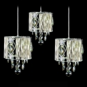 Delicate Polished Chrome Finish Frame and Beautiful Crystal Detailing Add Charm to Delightful Multi-Light Pendant