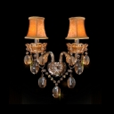 Lustrous Double Light Wall Sconce with Graceful Curving Arms and Clear Crystal Drops