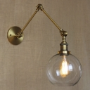 Adjustable Indoor LED Wall Lamp with Clear Glass Shade in Brass Finish