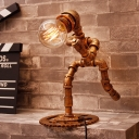 Industrial Pipe Featured Aged Bronze Metal Table Light in Shape of Running Man