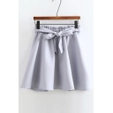 Elastic Waist Bow Tie Front Solid Color A-Line Mini Skirt