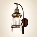 Industrial Wall Sconce with Lantern Style Metal Cage and Clear Glass Shade in Bronze