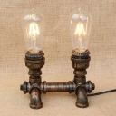 Industrial Desk Lamp with Pipe Lamp Base in Open Bulb Style in Aged Bronze