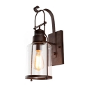 Industrial Wall Sconce with Clear Glass Metal Lantern in Rust