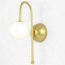 Industrial Wall Light with Globe Glass Shade in Gold Finish