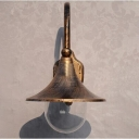 Industrial Wall Sconce with Clear Glass Shade in Aged Brass Finish