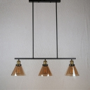 Industrial 34''W Island Light with Cone Glass Shade in Amber, 3 Light