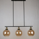 Industrial 34''W Island Light with Globe Glass Shade in Amber, 3 Light
