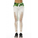 Fashionable Leaf Printed Color Block Hollow Out Skinny Leggings