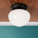 Mushroom Shape Flush Light Fixture Minimalist Milky Glass Single Light Ceiling Fixture in Black