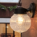 Single Light Orb Wall Lighting with Clear Textured Glass Modern Wall Lamp in Black for Balcony