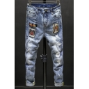 Fashion Embroidery Badge Patched Destroyed Light Blue Ripped Jeans