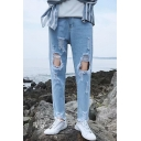 Men's Street Style Knee Cut Raw Hem Casual Light Blue Ripped Jeans with Holes