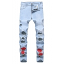 Men's Fashion Floral Embroidery Cut Up Slim Fit Light Blue Ripped Jeans with Holes