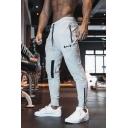 Men's New Stylish Letter Drawstring Waist Zip Pocket Fitness Slim Pencil Pants