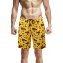 Men's Trendy Tropical Plants Print Drawstring Waist Loose Fit Beach Swim Trunks in Yellow