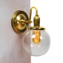 Antique Style Orb Wall Light Single Light Metal and Clear Glass Wall Sconce in Brass for Study