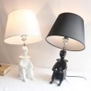 Contemporary Tapered Desk Lamp Fabric 1 Light Black/White Table Light with Human Decoration for Office