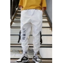Men's Street Style Graphic Pattern Buckle Strap Flap Pocket Design Ribbon Embellished Hip Pop Casual Cargo Pants