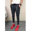 Guys Trendy Black Stripe Pattern Letter Ribbon Embellished Drawstring Waist Casual Skinny Pencil Pants
