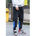Guys Trendy Colorblock Letter Printed Drawstring Waist Elastic Cuffs Casual Loose Tapered Track Pants