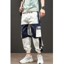 Men's Stylish Colorblocked Buckle Strap Design Flap Pocket Side Elastic Cuffs Hip Pop Casual Loose Cargo Pants